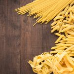 44117888 - mixed dried pasta selection on wooden background.